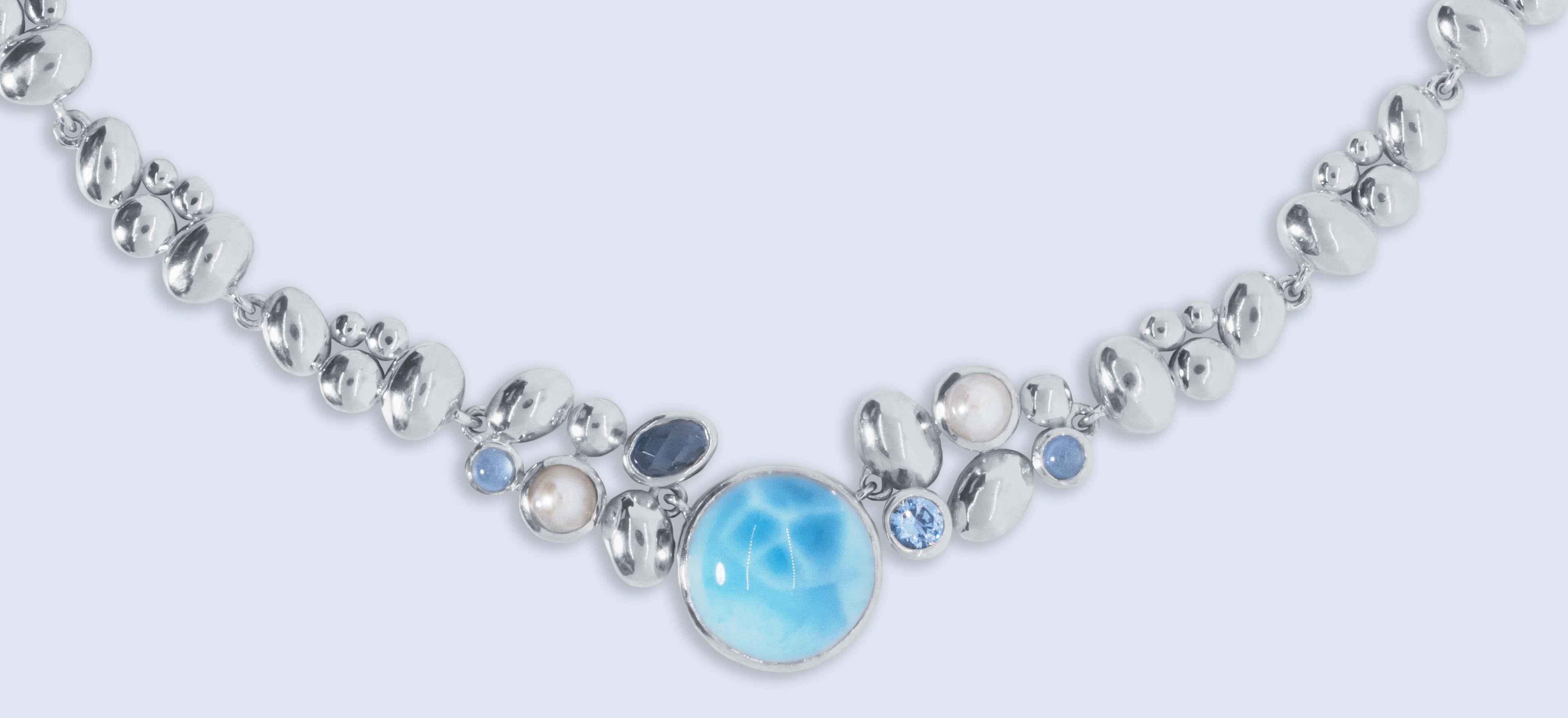 Clean sterling silver larimar gemstone jewelry