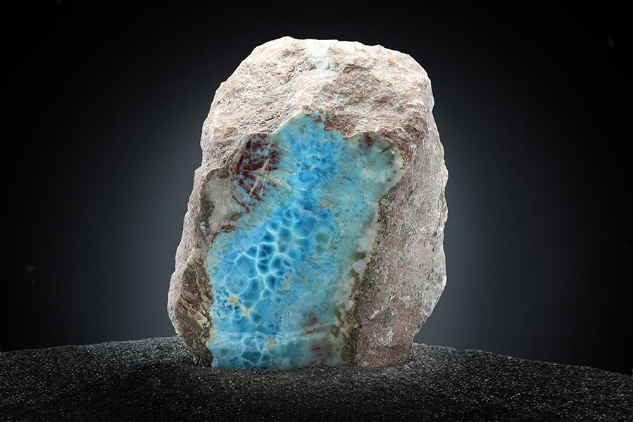 Cut Larimar stone. There is deep blue marbling, sign that it can be made into high quality jewelry.